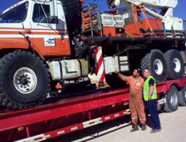 Crane & Safety advisor discussing with the operator of this National crane which had to be recovered from the job site, Central Sahara